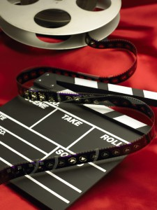 Movie clapboard and film reel